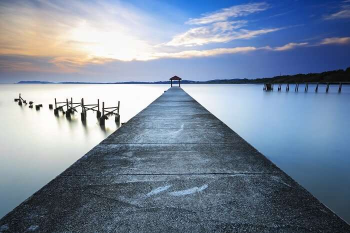 Stunning vibrant sunset at jetty of fisherman beach in Port Dickson