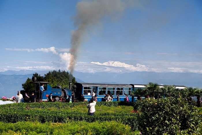 Toy train in Darjeeling on the background of mount Kanchenjunga