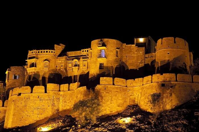 A night shot of the Jaisalmer Fort standing on the ridge of yellowish sandstone
