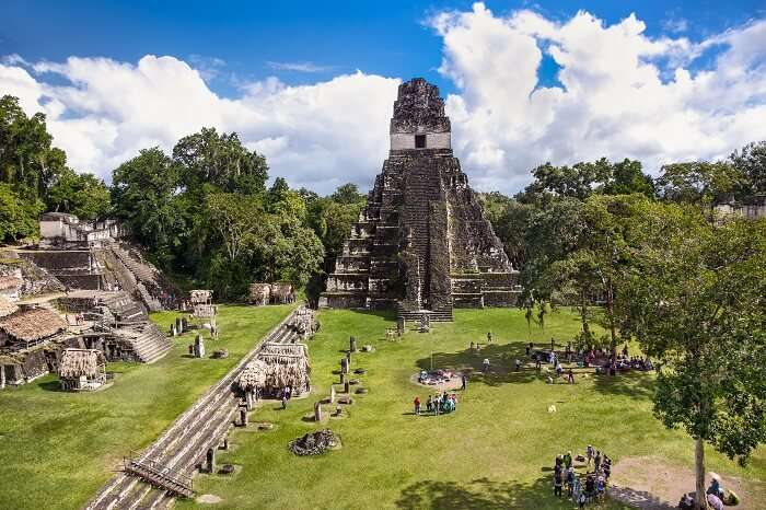 Tourists at the Gran Plaza at the archaeological site Tikal in Guatemala