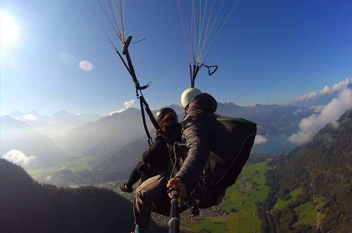 Honeymoon Couple paragliding in Switzerland