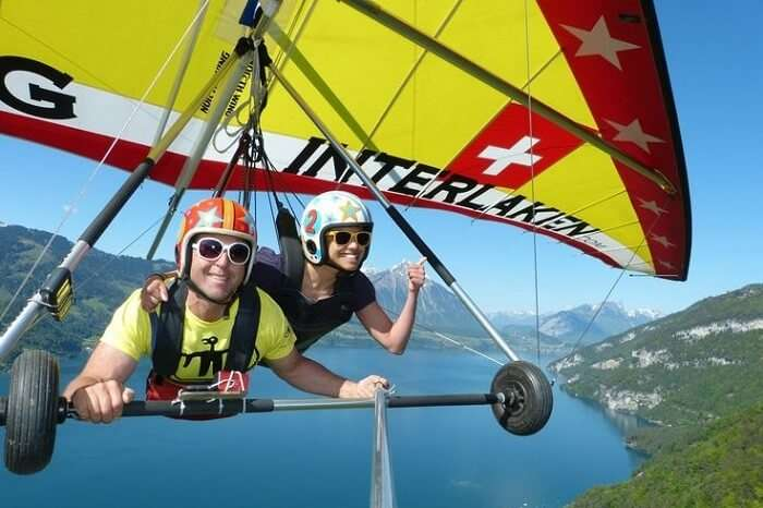 honeymoon couple hang gliding in Italy