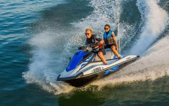 Honeymoon couple jet skiing in Australia
