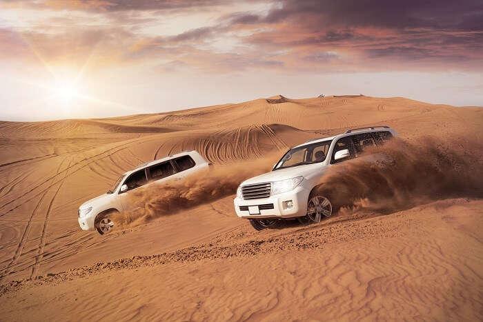 Honeymoon couple dune bashing in Dubai