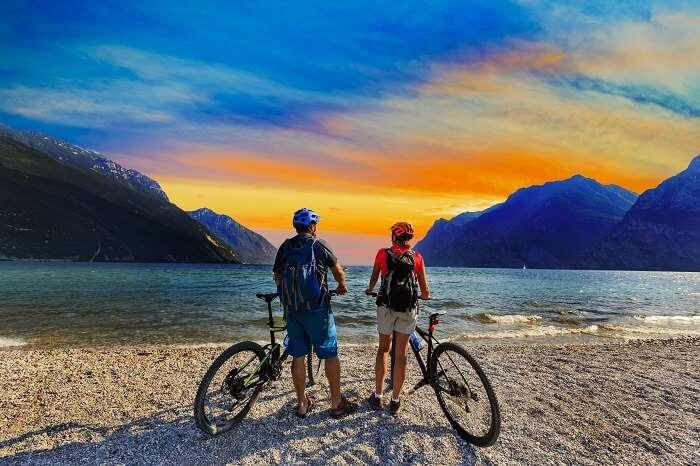 Honeymoon couple mountain biking in Italy