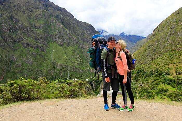 Romantic couple trekking on honeymoon