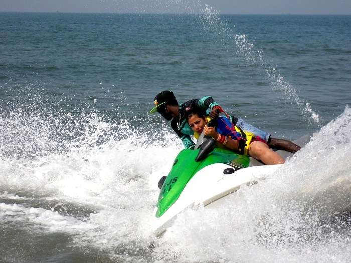 Couple doing water sports in Goa