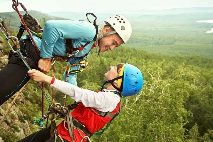 Romantic couple rock climbing in Utah
