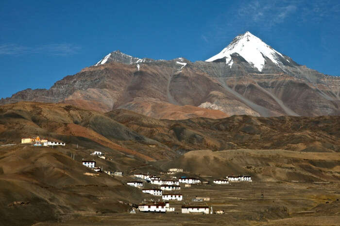 Snow capped mountains in the backdrop of Komic village in Spiti