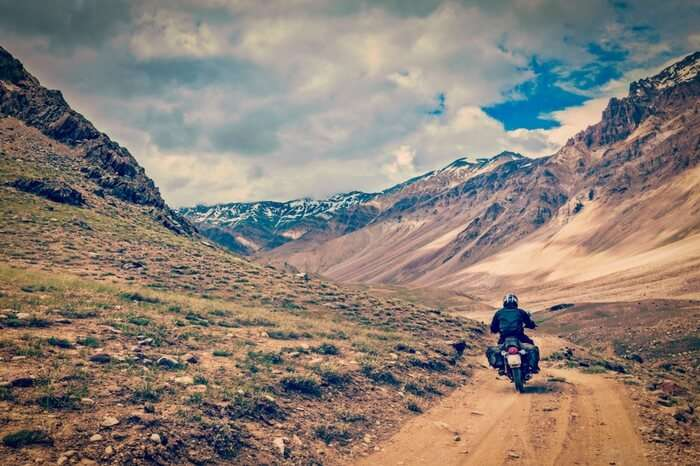 A biker on a mountain road in Spiti Valley