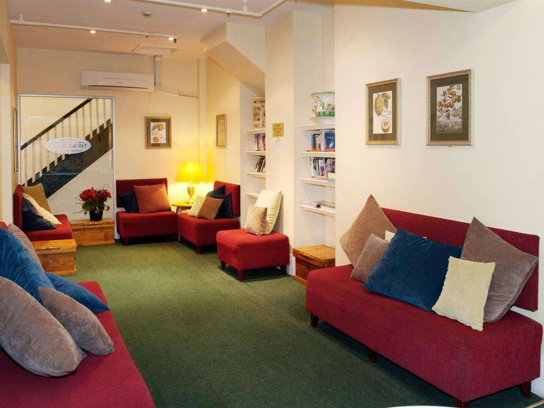 Hotel Claremont living room with red velvet sofas
