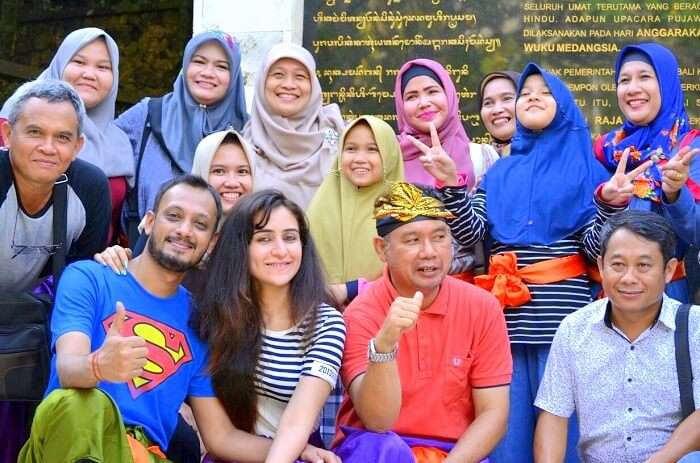 Sanchit and his wife have a group picture with the locals of Bali