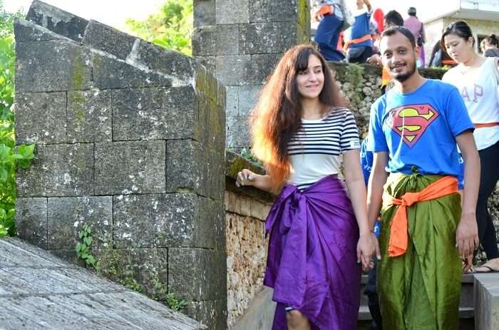 Sanchit and his wife explore the Uluwatu temple in Bali