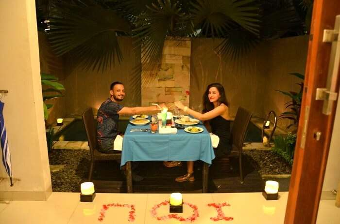 Sanchit and his wife enjoying Candle light dinner in Bali