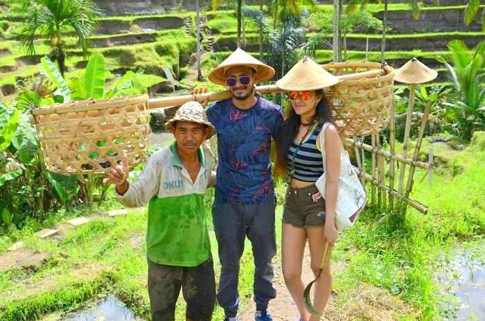 A couple with locals on their eco-tourism honeymoon in Ubud