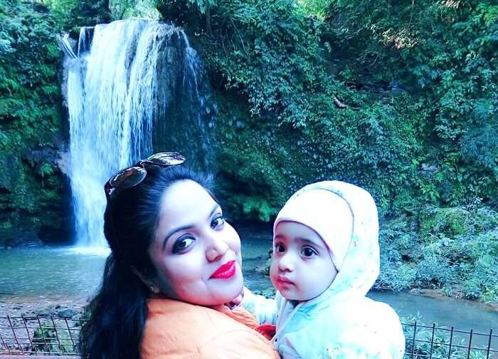 posing in front of corbett waterfall