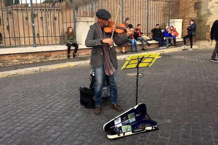 An artist playing a tune in Rome