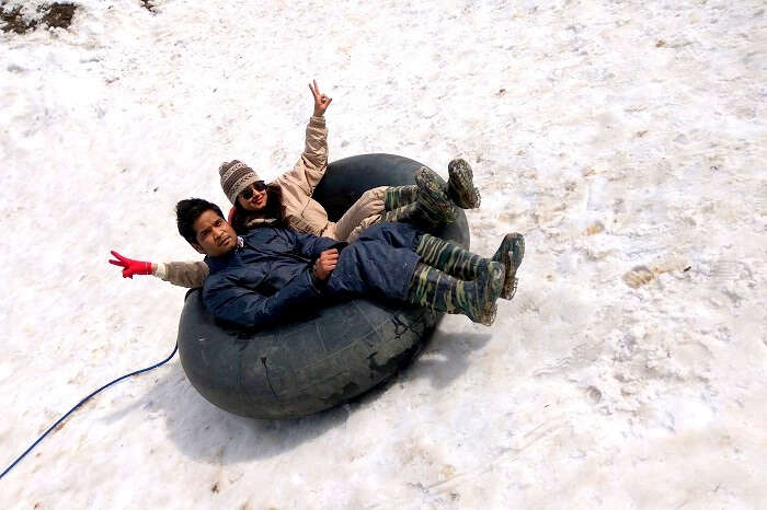 sliding down a slope in kufri