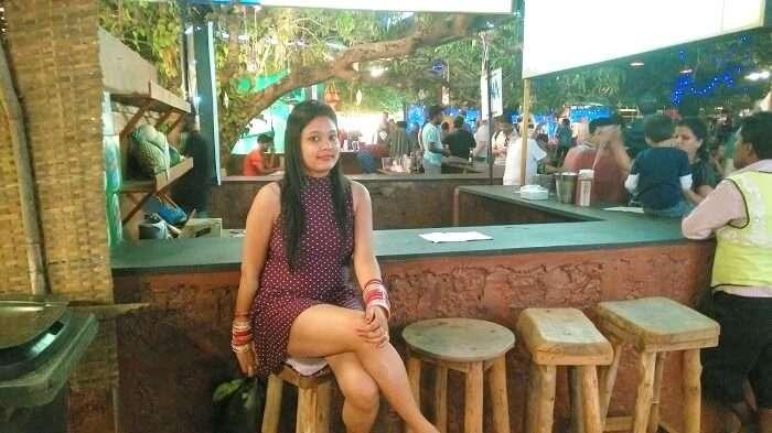 Female tourist in Goa restaurant