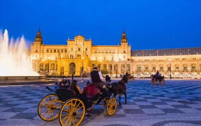 Horse carriage ride in Seville during evening