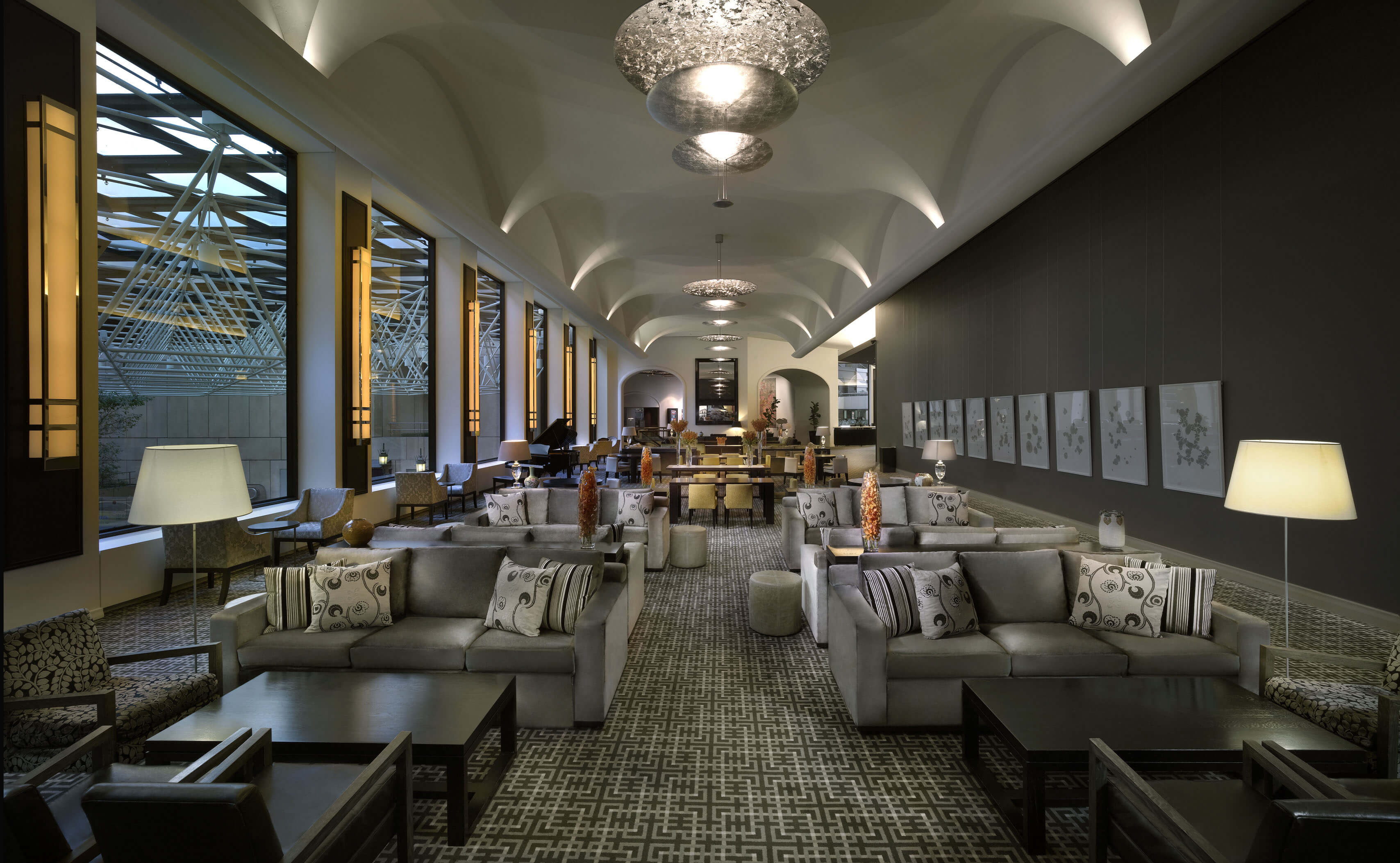 Sofitel on Collins cafe with gray decor and sofa