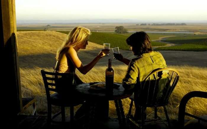 A couple enjoying wine in Tuscany