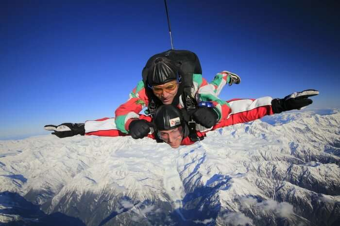 Skydiver enjoying diving session in the Franz Josef region in New Zealand