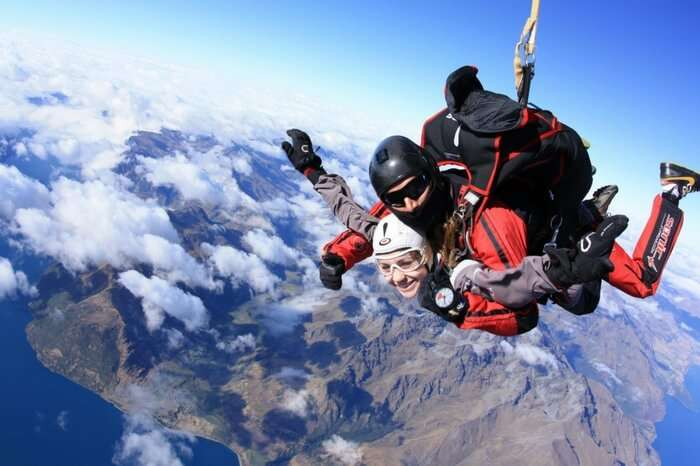 Adventurers during a skydiving session in Queenstown in New Zealand