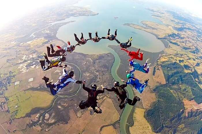 Professional skydivers performing aerobatics in Auckland