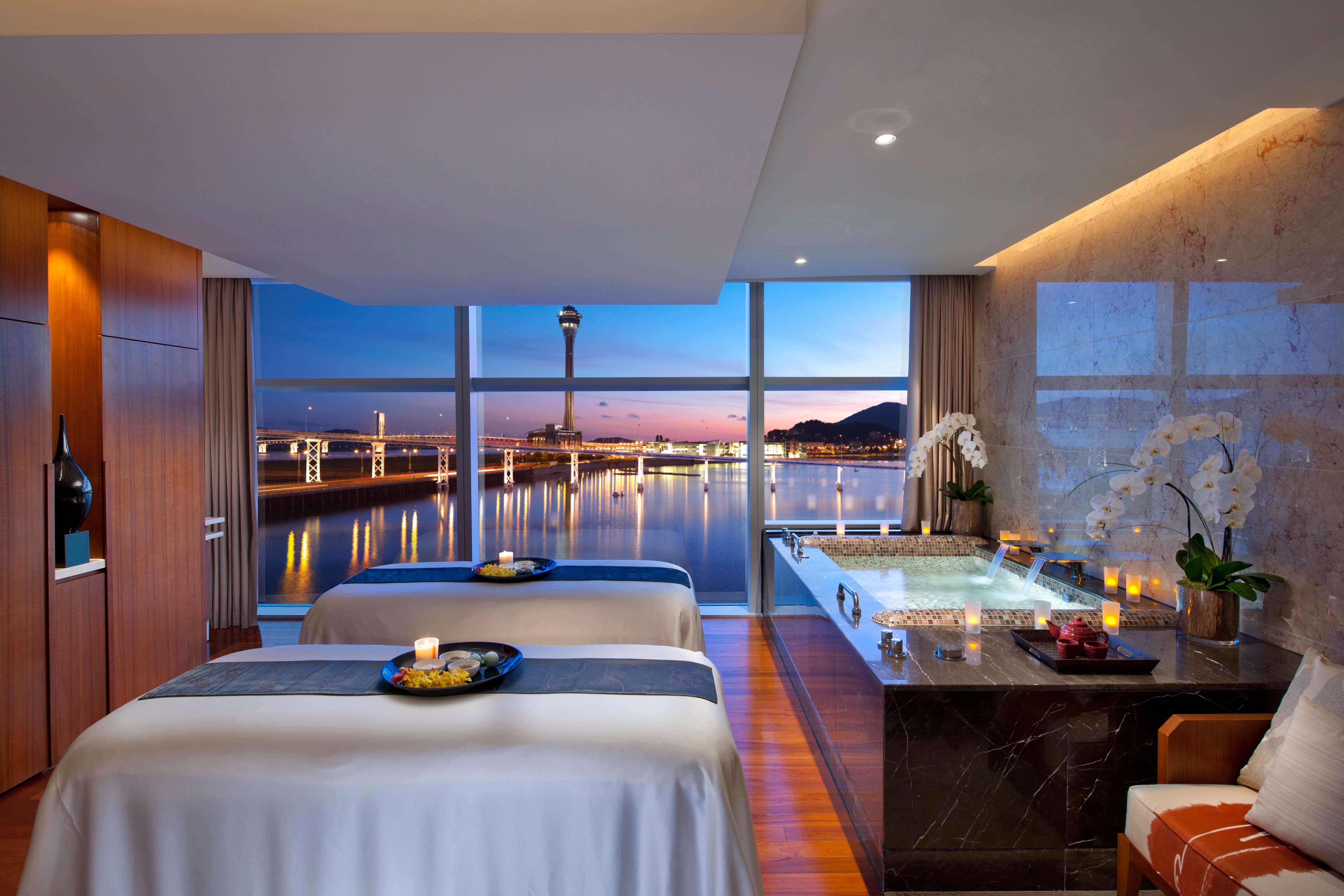 Spa treatment room with a luxury bathtub