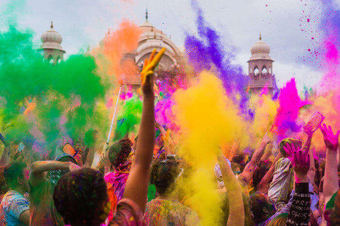 people play holi with colourful gulal
