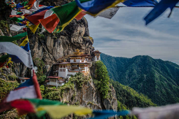 Prayer flags fluttering at Taktsang monastery