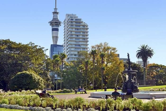 A view of the fountain at the centre of the Albert Park with Auckland tower in the background