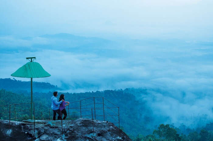 A couple at theview point of Cybe Hill Resort in Wayanad