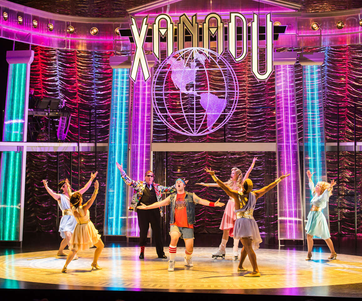 artists performing on the stage of Xanadu