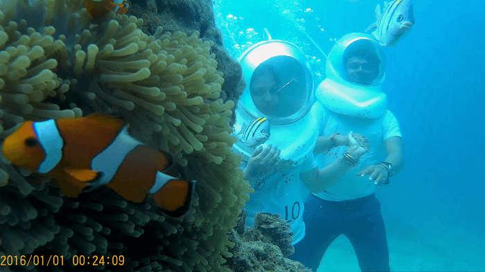 Couple enjoying Underwater seawalking in Andaman