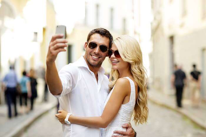 Romantic honeymoon couple clicking selfie