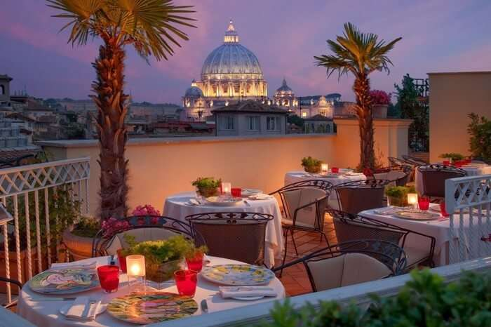 candlelit dinner from rooftop restaurant with Rome city view