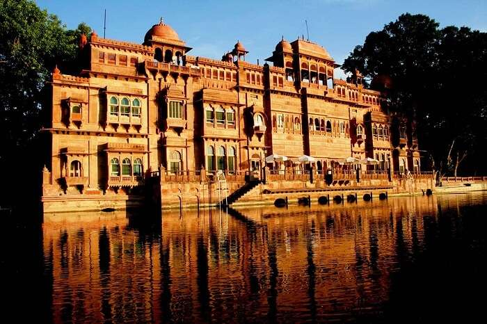 A shot of the Gajner Palace by the lakeside in Bikaner