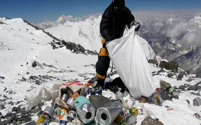 A volunteer cleaning up the trash in the Himalayas
