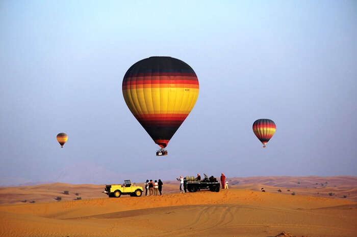 Travelers taking up hot air balloon ride during desert safari in Dubai