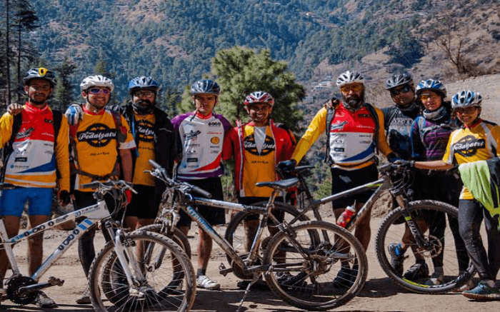 Group of mountain bikers promoting responsible travel in Himachal