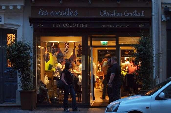 Guests entering the Les Cocottes de Christian Constant near Eiffel Tower in Paris