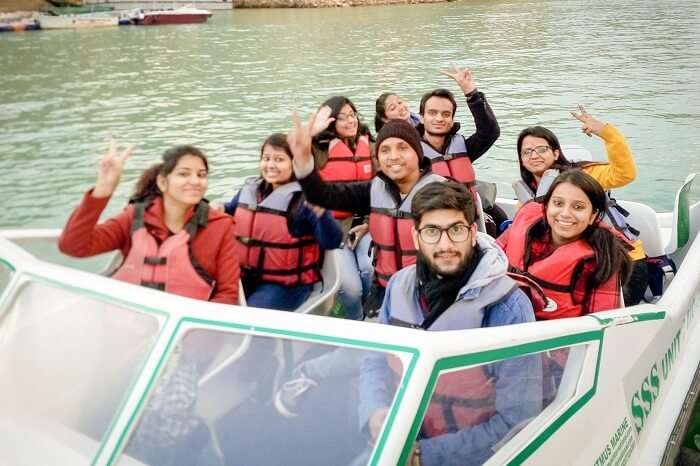 A group of tourists enjoy a speed boat ride in Tehri Dam at Kanatal