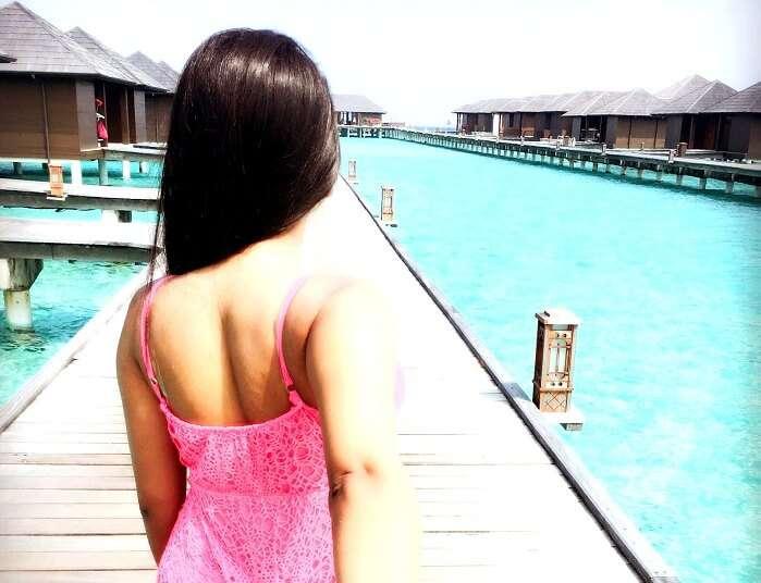 Girl enjoying Sea therapy in maldives