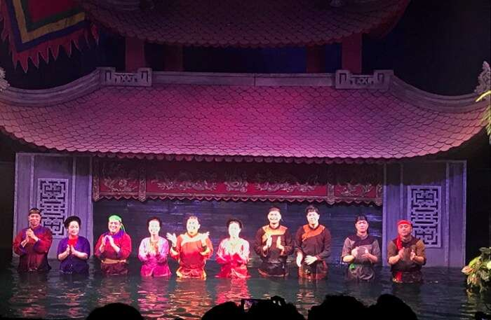 Enjoying water puppet show at night