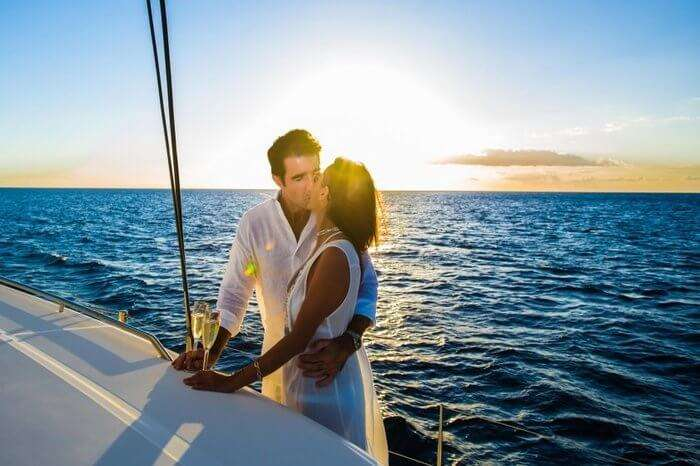 A couple kissing onboard catamaran