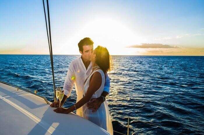 A couple kissing onboard catamaran