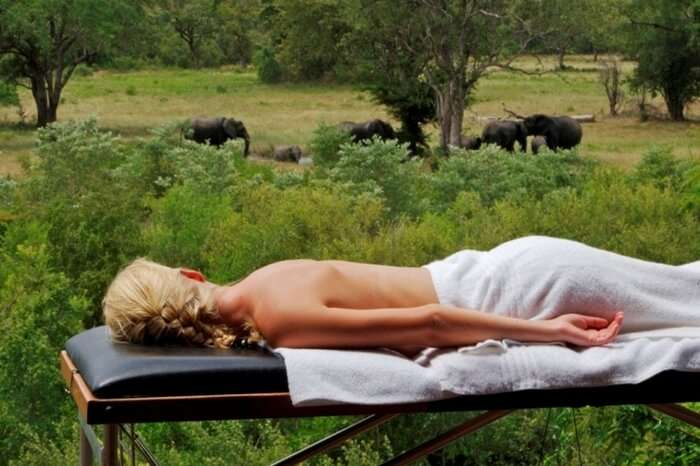 Honeymooner getting a massage during a safari honeymoon in Sabi Sand