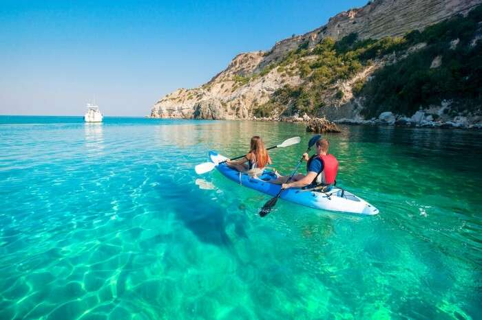 A couple boating in Naxos in Greece